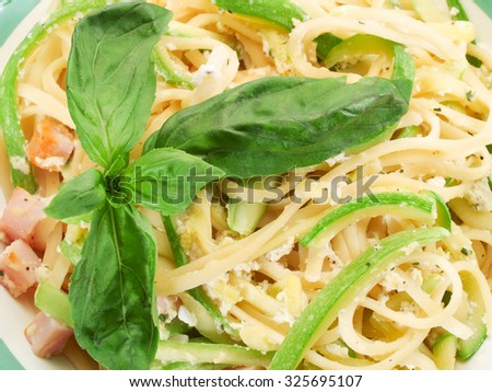 Spaghetti with zucchini, cream and cheese shot from above. Close up.