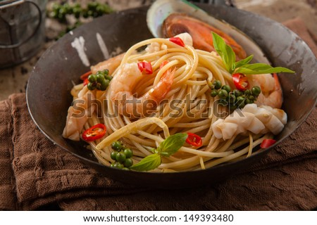 SpaghettiSeafood of topped with shrimp. - stock photo