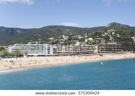 Spain. A beach in the resort Tossa de Mar.   View from the sea.