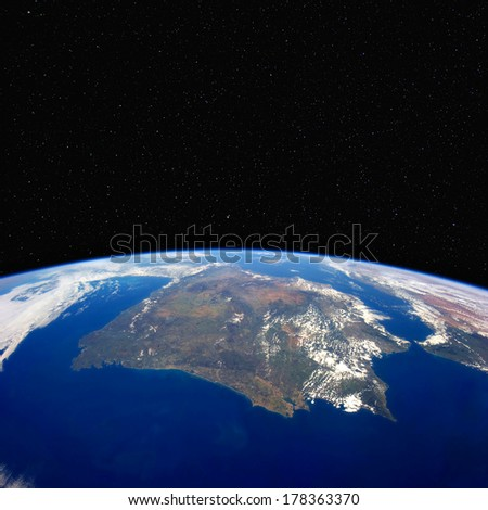 Spain and Portugal from space. Stars in the background. Elements of this image furnished by NASA. - stock photo