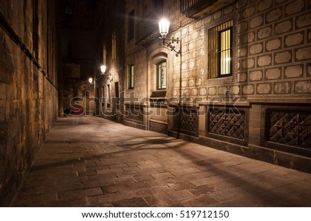 Spain, Barcelona, Gothic Quarter (Barri Gotic), Old Town, narrow street by night, historic city centre