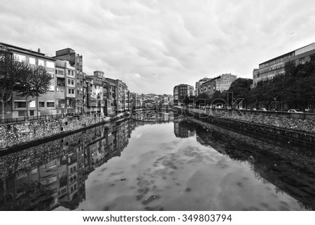 Spain, black and white photo overlooking the town from the river - stock photo