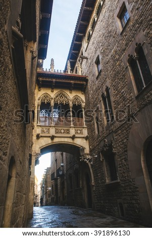 Spain, Catalonia, Barcelona, Bisbe Street in the Gothic Quarter of Barcelona, one of the most characteristic streets of the city, for its Gothic bridge. - stock photo