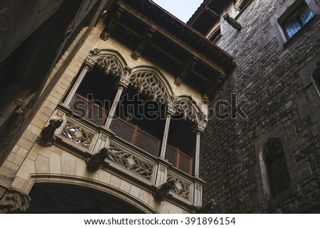 Spain, Catalonia, Barcelona, Gothic bridge in Bisbe Street in the Gothic Quarter of Barcelona, one of the most characteristic streets of the city. - stock photo