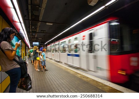 Spain, Catalonia, JUNE 14, 2013: Barcelona metro station with train in motion. ISO 1250, grain and noise. Editorial use only - stock photo