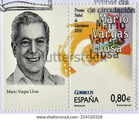 SPAIN - CIRCA 2011: a stamp printed in Spain showing an image of Nobel prize winner Mario Vargas Llosa, circa 2011.  - stock photo