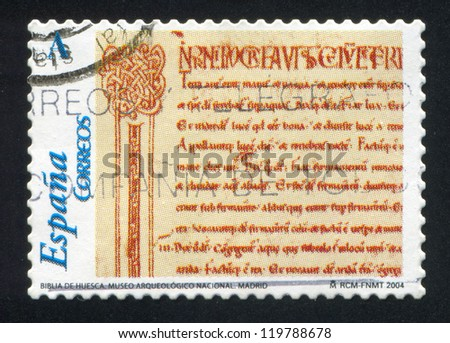 SPAIN - CIRCA 2004: stamp printed by Spain, shows Huesca Cathedral Bible page, national archaeological museum, Madrid, circa 2004 - stock photo