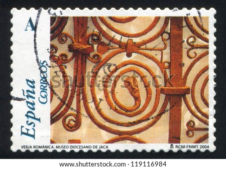 SPAIN - CIRCA 2004: stamp printed by Spain, shows Wooden carved crucifix, Diocesan Museum, Jaca, circa 2004 - stock photo