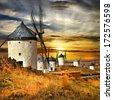 Spain,Consuegra. windmills on sunset,  - stock photo