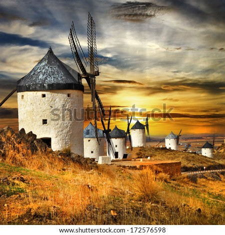 Spain,Consuegra. windmills on sunset,  - stock photo