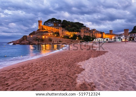 Spain, Costa Brava, Tossa de Mar at dusk, Platja Gran, main beach at Mediterranean Sea and castle - walled Old Town