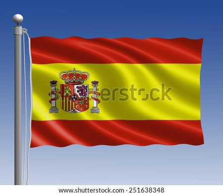Spain flag in pole on blue sky background - stock photo