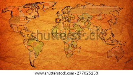 spain flag on old vintage world map with national borders - stock photo