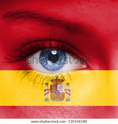 Spain flag painted on face - stock photo
