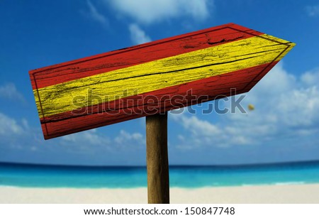 Spain flag wooden sign with a beach on background - Europe - stock photo