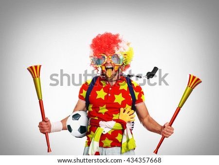 Spain football fan in a red wig and horns - stock photo