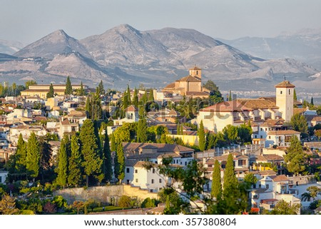 Spain, Granada. In the foreground of the Arab quarter, in the background the mountains of the Sierra Nevada - stock photo