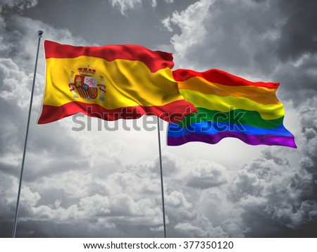 Spain & LGBT Community Pride Flags are waving in the sky with dark clouds