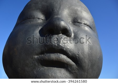 SPAIN, MADRID - MARCH 12, 2016: This sculpture of Antonio Lopez represents the face of one of his grand daughters when she was baby