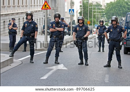 Spain, Madrid - May 26: Spanish Police by closing the street to the Congress building during the Protests in Spain against the spanish economic crisis and political system in Madrid on May 26, 2011. - stock photo