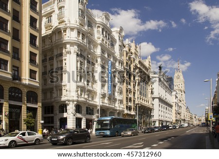 Spain,Madrid - May 27, 2016: Traffic of cars and busses in the Gran Via main street in Madrid, Spain on May 27, 2016 - stock photo