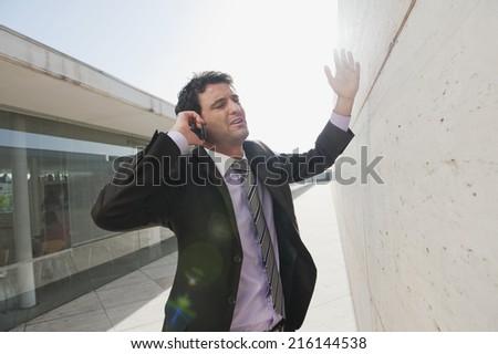 Spain, Mallorca, Businessman using mobile phone, gesturing - stock photo