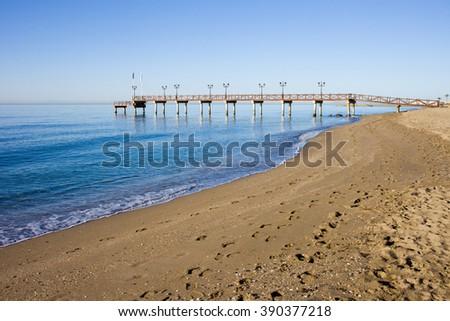 Spain, Marbella, Costa del Sol, sandy, empty beach at Mediterranean Sea (Alboran Sea) - stock photo