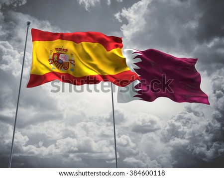 Spain & Qatar Flags are waving in the sky with dark clouds