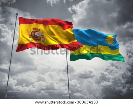 Spain & Rwanda Flags are waving in the sky with dark clouds