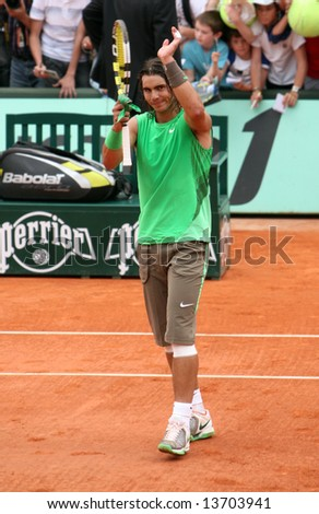 Spain's top tennis player Rafael Nadal applauds after winning a match at Roland Garros 2008, French Open, Paris, France - stock photo
