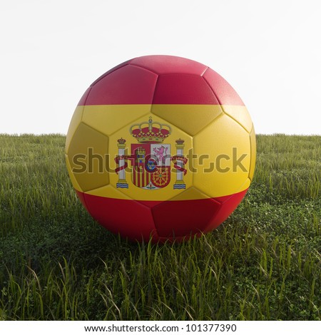 spain soccer ball isolated on grass - stock photo