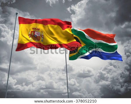 Spain & South Africa Flags are waving in the sky with dark clouds