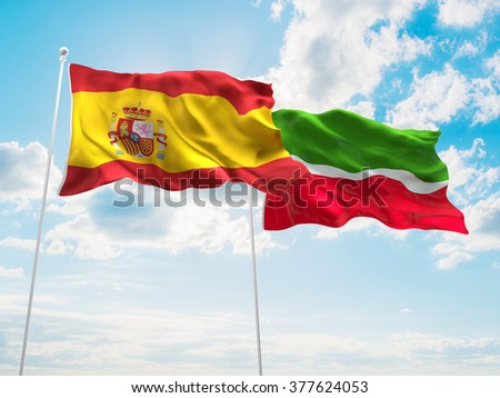Spain & Tatarstan Flags are waving in the sky