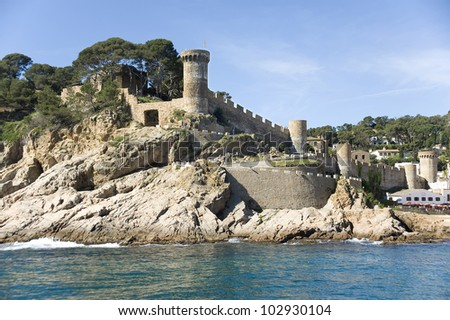 Spain. Tossa de Mar. A view of a fortress from the sea - stock photo