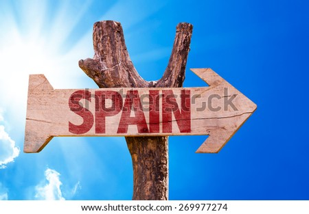 Spain wooden sign with sky background - stock photo