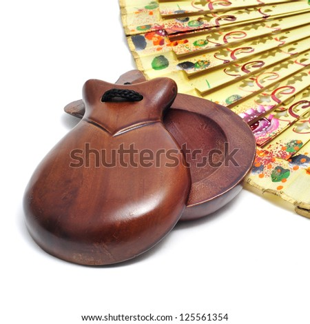 spanish castanets and hand fan on a white background - stock photo