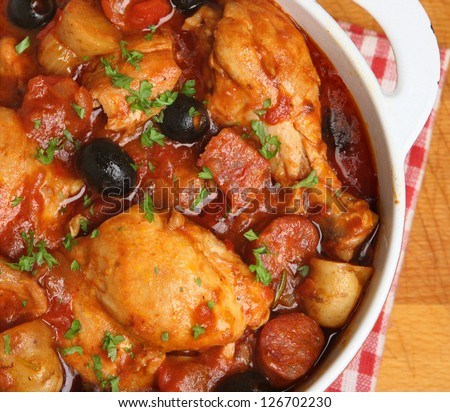 Spanish chicken casserole with chorizo, olives and new potatoes. - stock photo