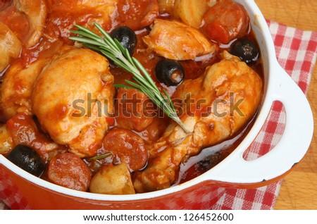 Spanish chicken stew with chorizo, olives and new potatoes. - stock photo