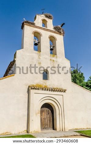 Spanish church in Avila with some nests of storks. Santa Maria de la Cabeza hermitage - stock photo