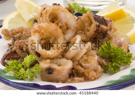 Spanish cuisine. Andalusian deep-fried squids. Chipirones a la andaluza. Selective focus.