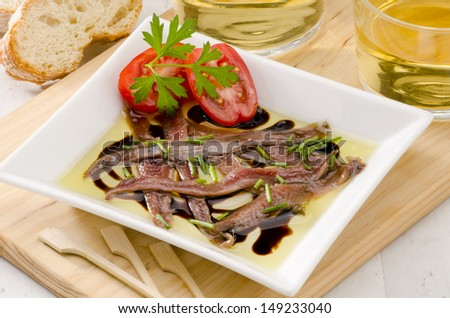 Spanish cuisine. Tapas. Marinated anchovies in olive oil. Selective Focus. Anchoas en aceite. - stock photo
