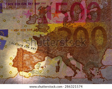 Spanish debt crisis -  Map of Europe in the dark, bright spot in Spain, translucent Euro Banknotes - stock photo
