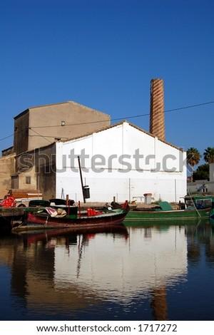 Spanish fishing village in the evening sun - stock photo