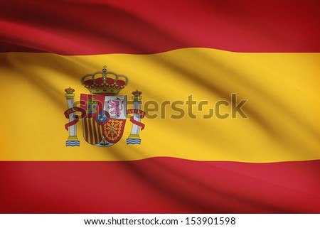 Spanish flag blowing in the wind. Part of a series. - stock photo
