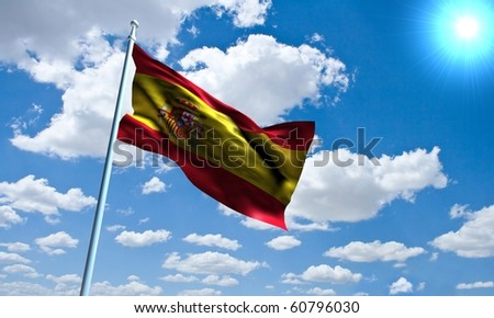 Spanish Flag in front of vivid, sunny, cloudy sky