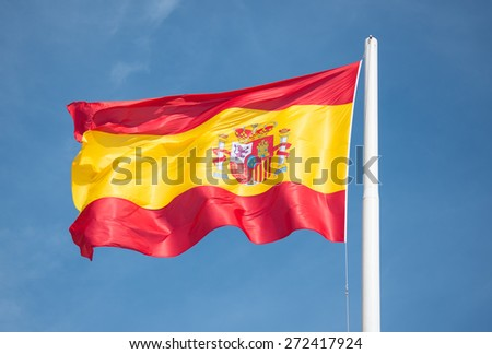 Spanish flag in the wind at high noon - stock photo