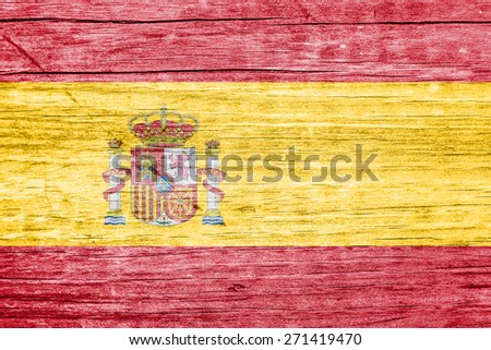 Spanish flag overlay on a wooden plank with wood nerves - stock photo