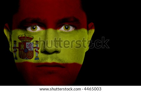 Spanish flag painted/projected onto a man's face.