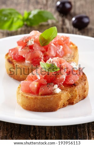 Spanish food tapas. Toasted bread with chopped tomato and basil