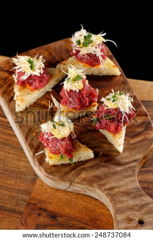 Spanish food tapas. Toasted bread with meat and vegetables - stock photo